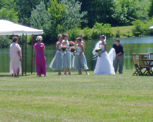 Bride by the pond in Lavender Green's East Meadow