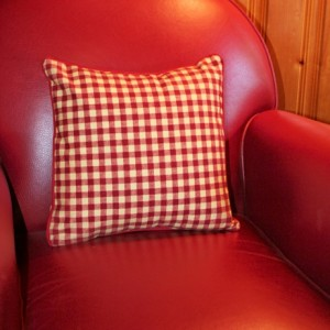Lavender and kapok-filled pillow. Checkered pattern red and straw.